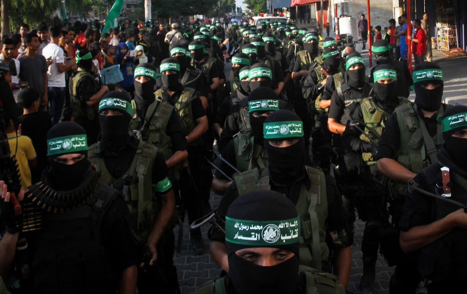 Palestinian Hamas militants take part in a military parade marking the first anniversary of the killing of Hamas's military commanders Mohammed Abu Shammala and Raed al-Attar, in Rafah, southern Gaza Strip, on August 21, 2015. Abu Shammala and al-Attar were killed by in Israeli air strike during a 50-day war between the armed group and Israel last summer. Photo by Abed Rahim Khatib /Flash90