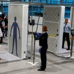 "The world's pilot innovative ""Easy Security"" system for passengers consisting of two full-body scanners and two automated luggage-X-ray lanes are seen during live operations at Cologne-Bonn's Konrad Adenauer Airport in Cologne, Germany, November 17, 2016.   REUTERS/Wolfgang Rattay    - RTX2U6GK"