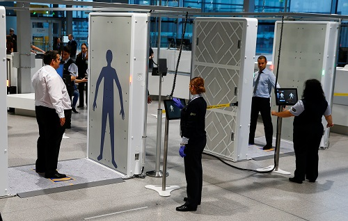 """The world's pilot innovative """"Easy Security"""" system for passengers consisting of two full-body scanners and two automated luggage-X-ray lanes are seen during live operations at Cologne-Bonn's Konrad Adenauer Airport in Cologne, Germany, November 17, 2016.   REUTERS/Wolfgang Rattay    - RTX2U6GK"""