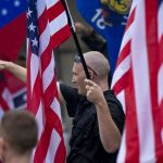 "A member of a white supremacy group gives the fascist salute during a gathering in West Allis, Wisconsin, September 3, 2011. Neo-Nazi demonstrators gathered for a ""rally in defense of white America"" in response to an incident that Milwaukee Police Chief described as racially charged violence outside the Wisconsin state fair on August 4, 2011. REUTERS/Darren Hauck (UNITED STATES) REUTERS/Darren Hauck (UNITED STATES - Tags: POLITICS CIVIL UNREST SOCIETY) - RTR2QRBL"