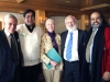 Michael Laitman posing with members of World Wisdom Council